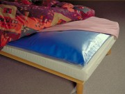 Mobile waterbed mattress topper